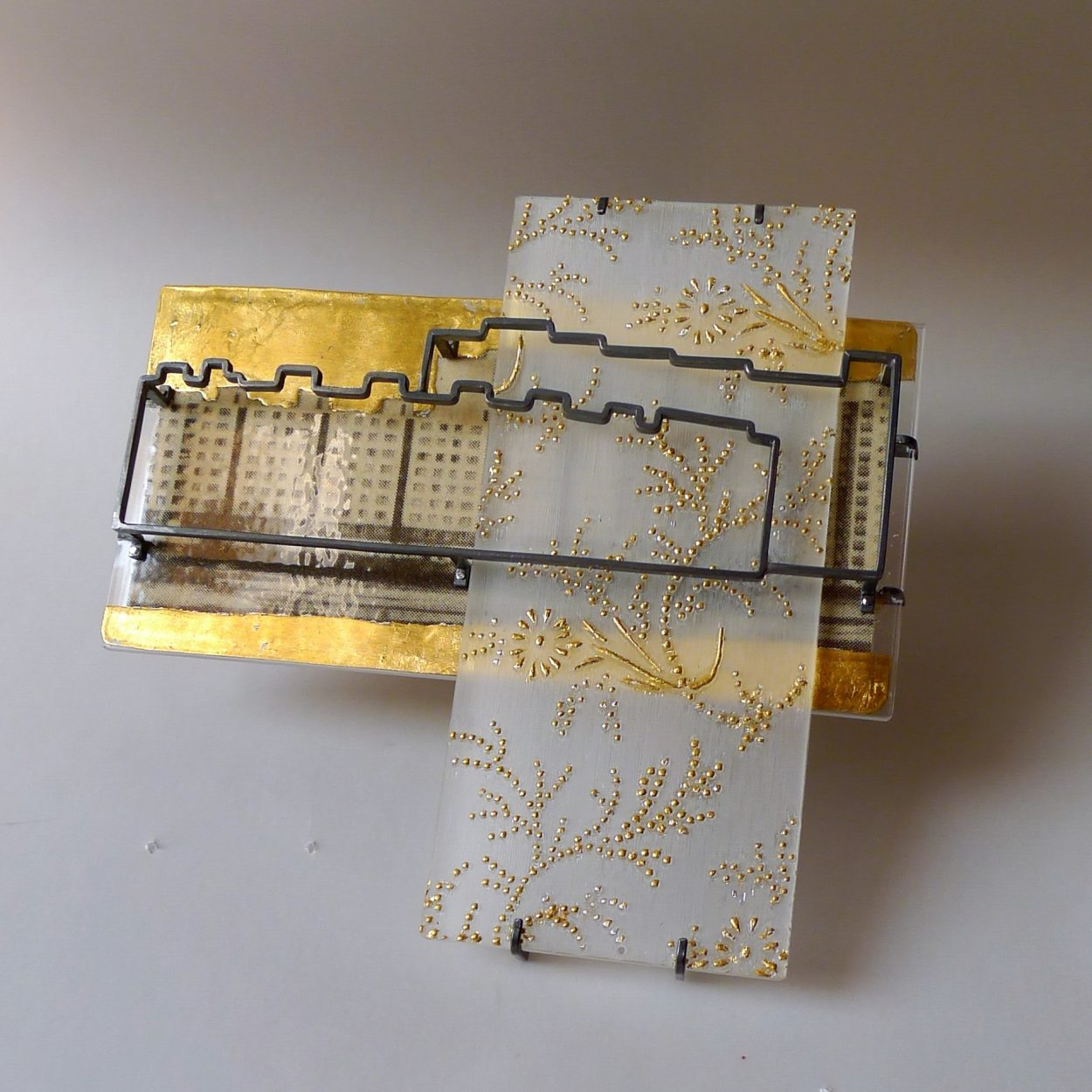 """Jana Machatová: """"Where are you from?"""" brooch, plexiglass,silver, paper in laminated plastic, gold foil (photo by Peter Machata)"""